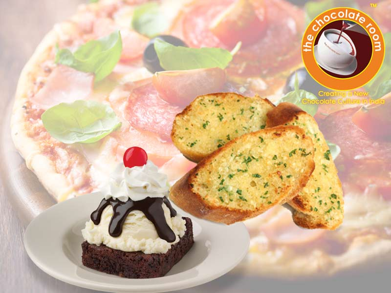 Chocolate Room Amritsar- Buy 1 PIzza, 1 Garlic Bread and Brownie Sanday/ Frappe Only for Rs.399