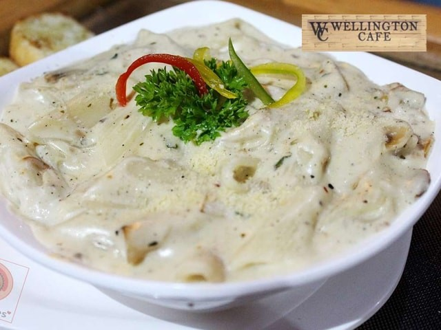 Wellington Cafe-Get 1 Veg Pasta (Red / White Sauce) + 2 Virgin Mojito in Rs. 179 Only